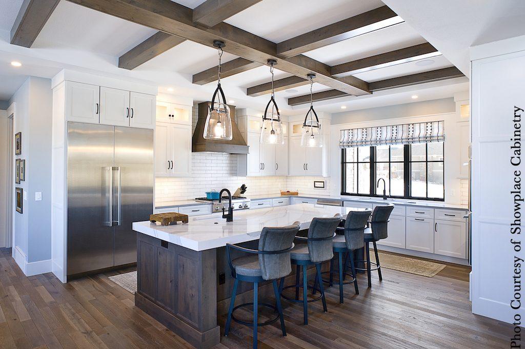 U-shaped kitchen layout, white, with wood beams and wood island