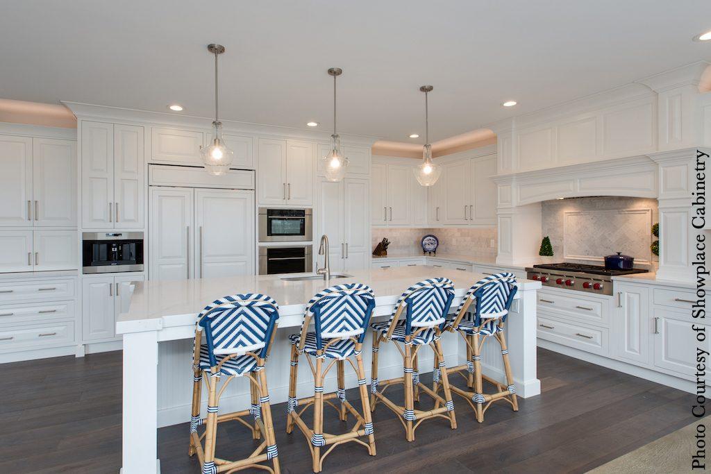 large, L-shaped kitchen layout, white with island