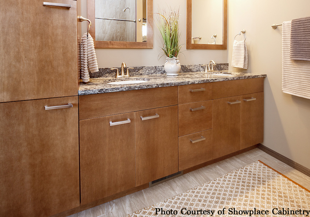 bathroom with maple storage cabinetry