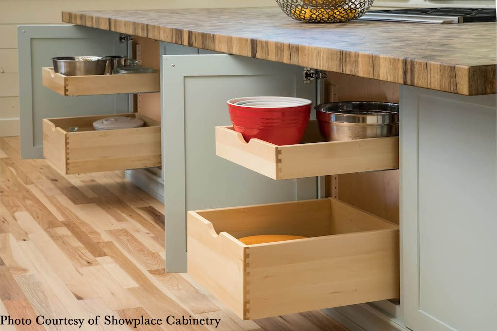 Under counter storage, blue cabinetry by Showplace cabinetry