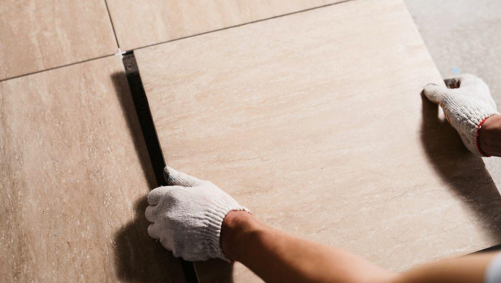 tiler laying bathroom flooring